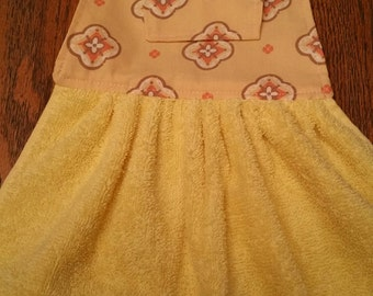 bright yellow, brown and pale orange hanging kitchen towel
