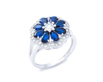 Rhodium plated Sterling Silver Floral ring w/Cz & Blue Spinel