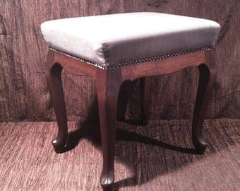 Light blue upholstered foot stool, cabriole legs, nail head trim, free shipping