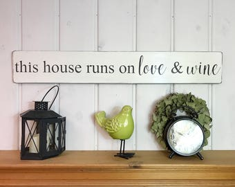 "This house runs on love & wine sign | wine decor | wine lover's gift | rustic wood sign | kitchen wall decor | 36"" x 5.25"""