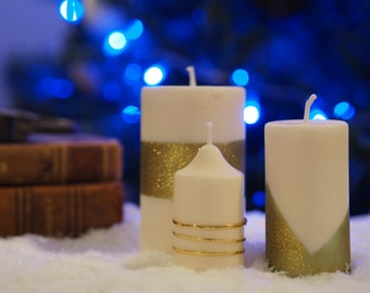 trio of white and gold candles