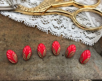 Tiny red oval glass buttons with gold handpainted detail