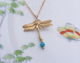 Gold plated and turquoise dragonfly pendant.