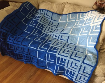 """Knitted blue 50""""x67"""" afghan"""