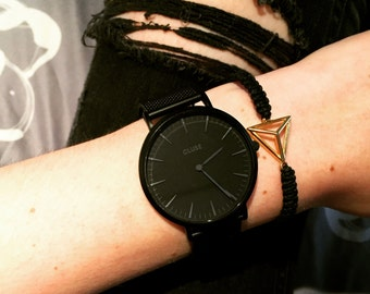 Bracelet with golden triangle
