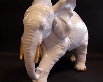 Large vintage porcelain elephant with Golden details
