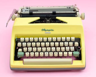 Yellow Olympia Monica typewriter
