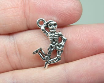 10 Silver Tone Dancing Skeleton Charms. B-004