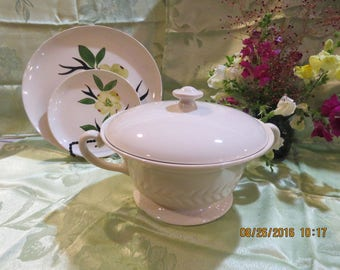 Covered bisque colored pottery serving bowl with two handles