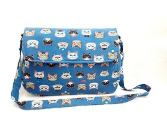 Blue cats cross body bag, blue cross body handbag, cat print handbag, cat lover handbag, cross body bag with a flap, blue messenger bag, cat