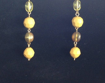 Beaded drop earrings .