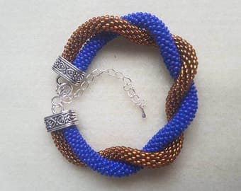 Handmade beaded bracelet. Blue and gold lined beads.