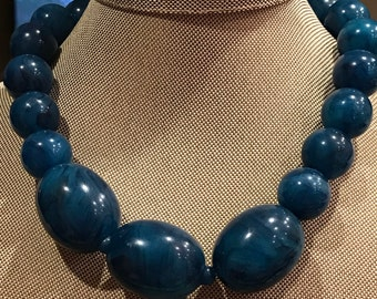 Lucite, chunky aqua blue necklace.