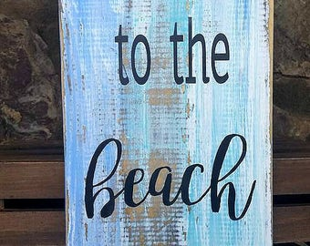 Love you to the beach and back.  Distressed weathered, hand painted wooden sign