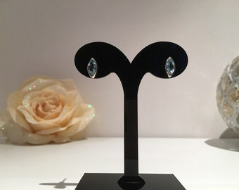 Gemstone Blue Topaz Stud Earrings of sterling silver (925). The stones are face cut.