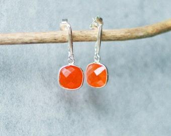 Silver earrings massif and carnelian orange