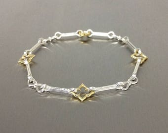 Silver and gold ladies bracelet.