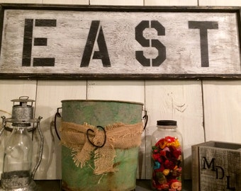 "Distressed ""EAST"" Sign"