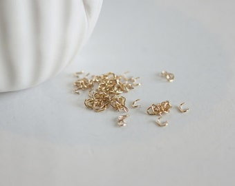 1 gram of small Golden oval rings 16 carats 4mm