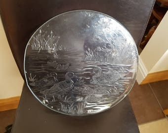 Glass cake dish with a duck and swan scene