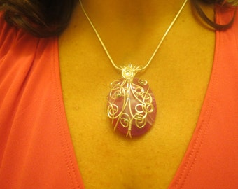 Beautiful Pink Agate oval, wrapped with silver plated wire, pendant