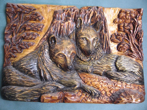 Wood carving relief wolves