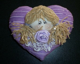 Handmade heart with baby doll
