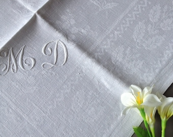 Antique damasked cotton tablecloth and 12 napkin with an embroidered monogram MD. Damask representing grapes