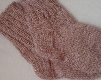 children knitted socks from alpaca