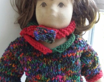 Colorful doll sweater with panels in red u green, with pass. Scarf