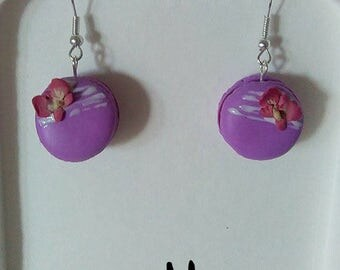 Earrings dangling orchids in polymer clay buttons.
