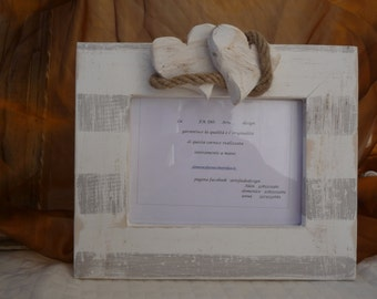 Shabby chic wooden frame with hearts