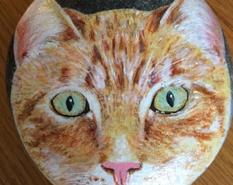 Hand painted ginger cat on a large pebble,