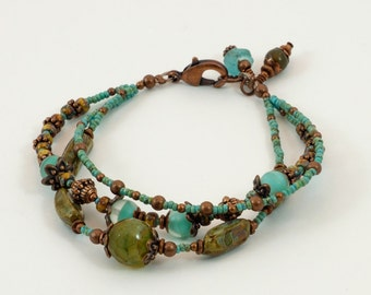 Sea Glass and Picasso beaded bracelet with bronze accents