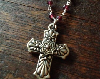 Talavera cross necklace on a garnet rosary chain.