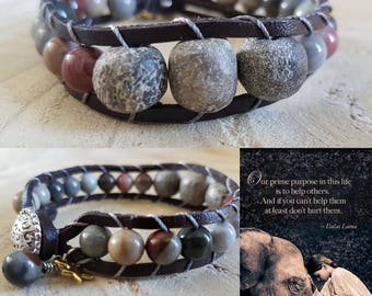 Wrapbracelet of leather with fossil elephant and ocean Jasper stone.