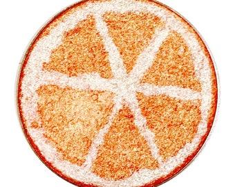 Fruity Orange - Fruit Highlighter shaped as an orange slice. Gold & Pink highlighter blush