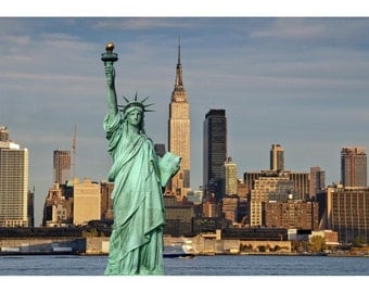Statue of Liberty with skyline of New York