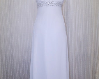 White chiffon sheath gown with jewelled straps and belt. SIZE 6