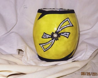 Yellow vase with charm