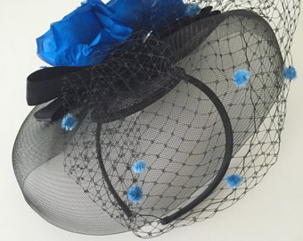 Black fascinator headband with royal blue flower