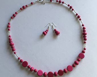 Bright pink beaded necklace and earring set.