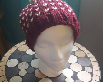 Cranberry and cream heart knit beanie.