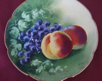 DECORATIVE hand painted antique porcelain plate