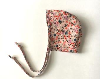tan floral bonnet.