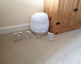 Hand knitted childs pouffe