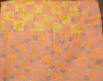 Pastel pink and yellow quilt top
