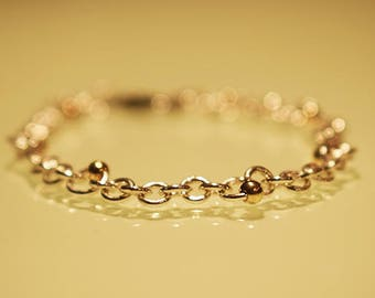 925 Silver Bracelet accented with 10K Solid Gold beading