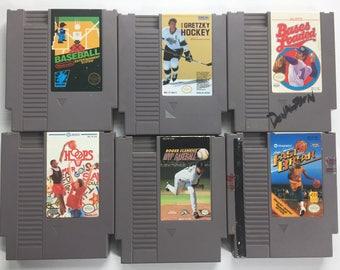 Original NES Games: Baseball, Wayne Gretzky Hockey, Bases Loaded, Roger Clemens' MVP Baseball, Hoops, Magic Johnson's Fast Break