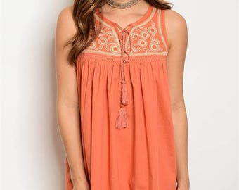 Embroidered burnt orange mini dress .